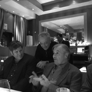 Jacques and Roland discuss the desserts, while Mitch looks on