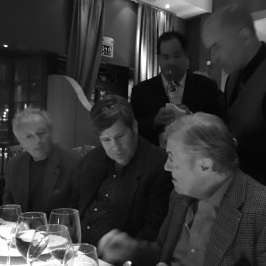 Jacques and Jean Claude discuss rabbit loins as Mitch looks on
