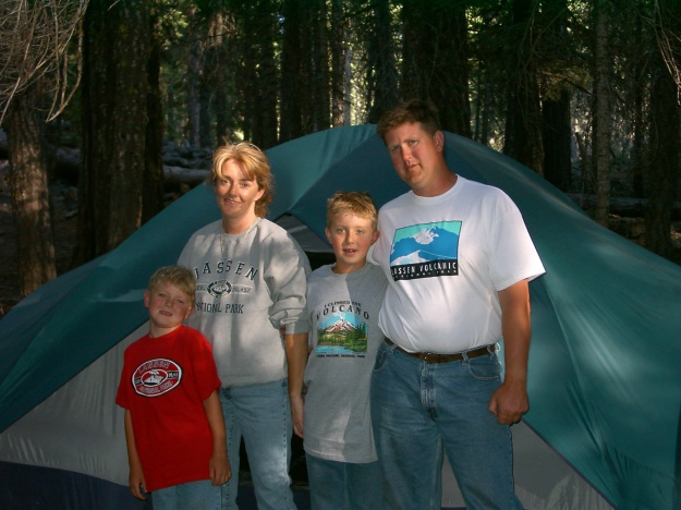 Camping in 2000. Looks like no one slept too well the night before!