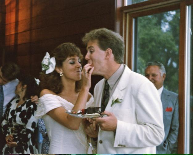 Enjoying some cake at the wedding