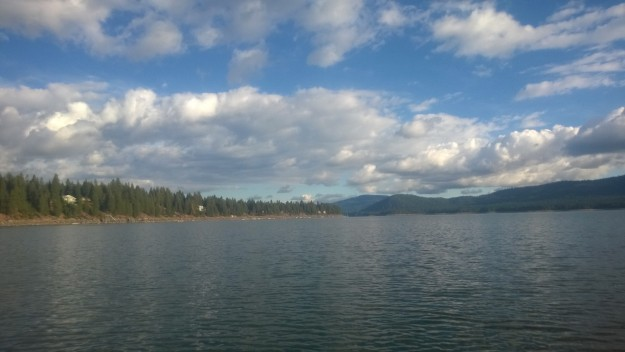 Calm lake and puffy clouds.
