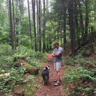 Roscoe hiking the woods near Northwest Bay